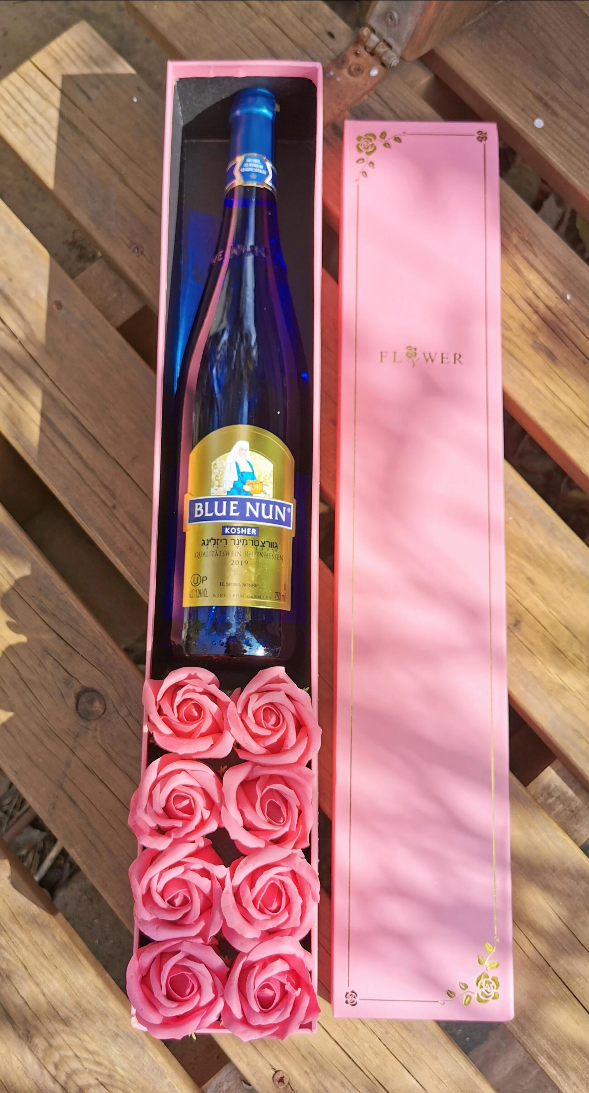 מארז שמפניה ופרחים